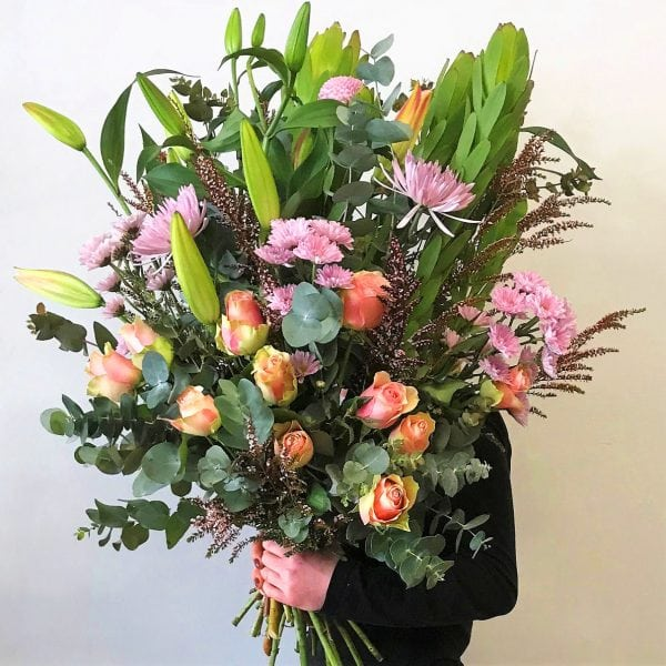 Premium bouquet of Lily, rose and seasonal pastel blooms